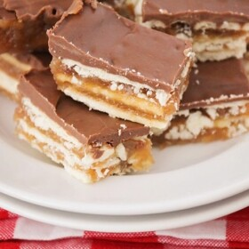 squares of christmas crack toffee on a plate