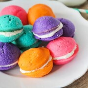 a plate full of pastel colored mini whoopie pies