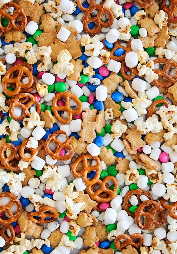 brightly colored snack mix on a pan