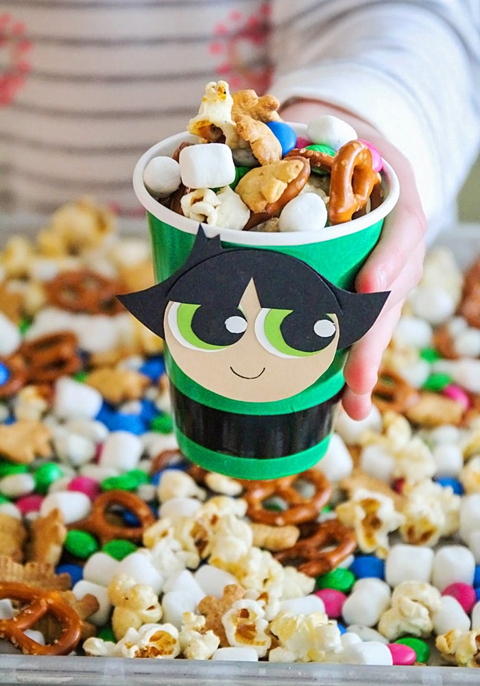 a powerpuff cup filled with snack mix