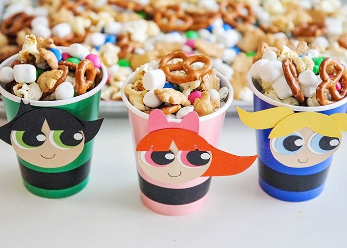 powerpuff girl cups filled with a trail mix