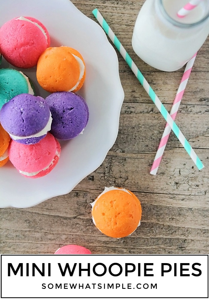 Add some fun to your food with these colorful mini Whoopie Pie Cupcake Poppers! A delicious frosting sandwiched between everyone's favorite part of a cupcake.. the cupcake tops! #cupcakes #cupcake #miniwhoopiepies #cupcakepoppers #howtomakeminiwhoopies via @somewhatsimple