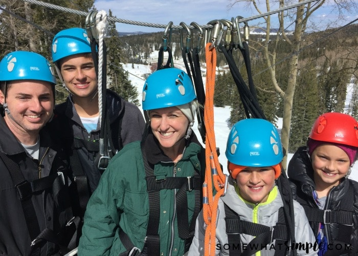an attractive family getting ready to zipline