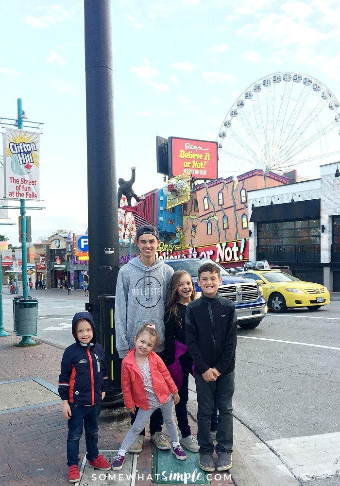 five children standing along the street at the Clifton Hill entertainment district at Niagara Falls, Canada