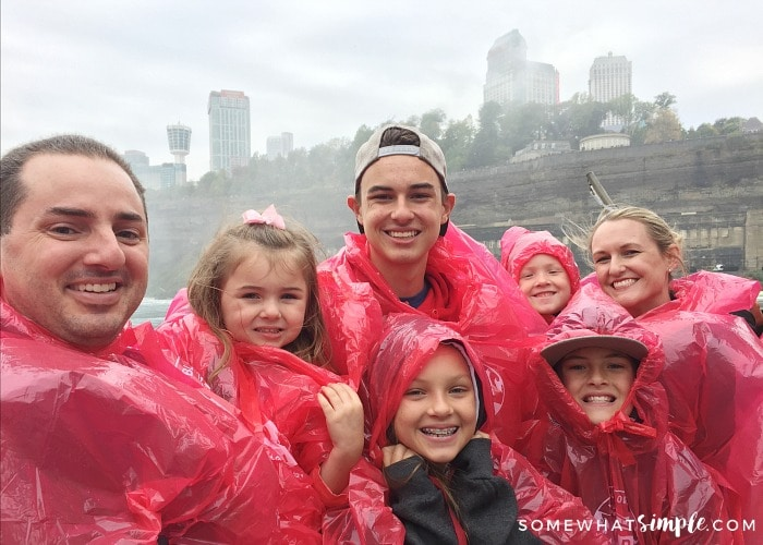 a family in red ponchos riding the Hornblower cruise boat to Niagara Falls
