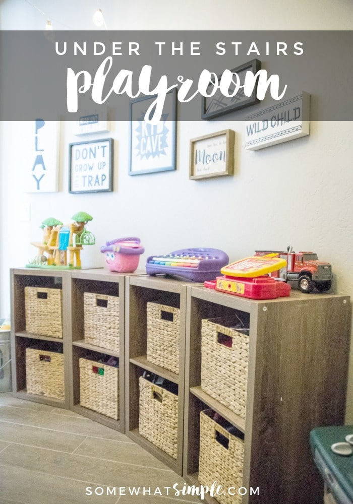 Take a look at how we turned a dark closet into a darling playroom under the stairs!