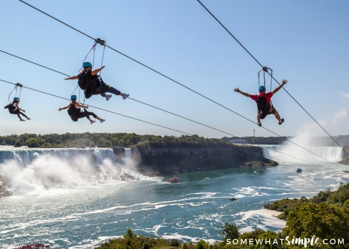 people zipling next to niagara falls