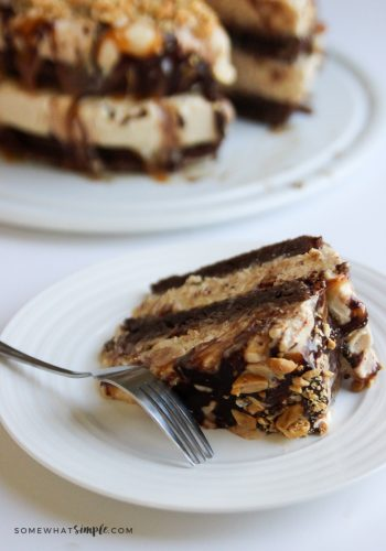 serving a slice of snickers ice cream cake