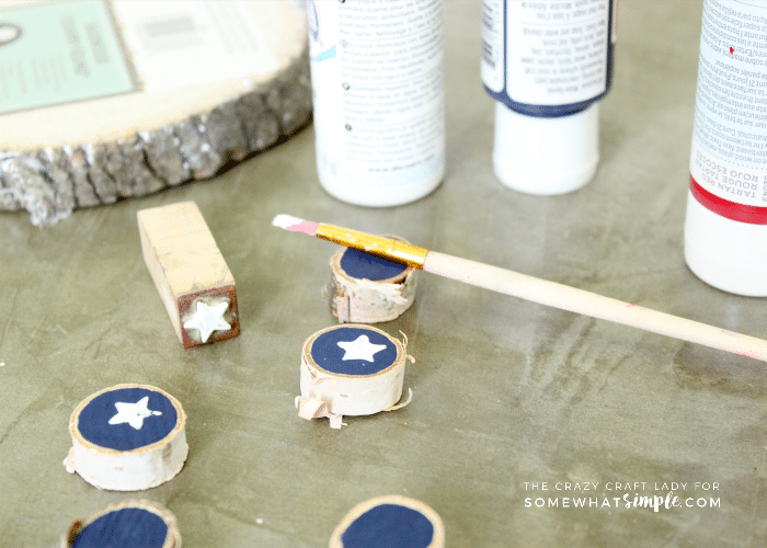 "This ""stars and stripes"" painted Tic-Tac-Toe game is the perfect summer craft. Paint wood slices to create a custom game board for hours of fun!"