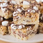 squares of s'mores rice krispie treats on a plate