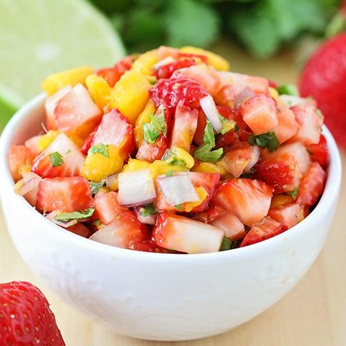 a bowl of strawberry mango salsa