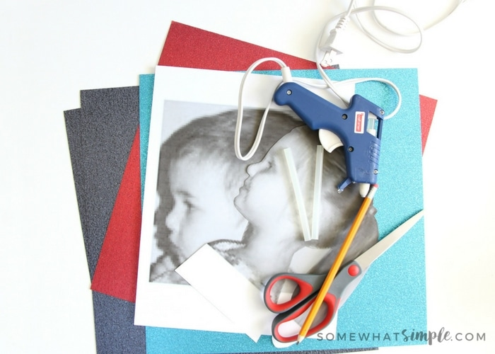 """I like to call this child silhouette craft """"Glitter Silhouettes."""" They are super simple to make, especially if you use glitter cardstock paper!"""