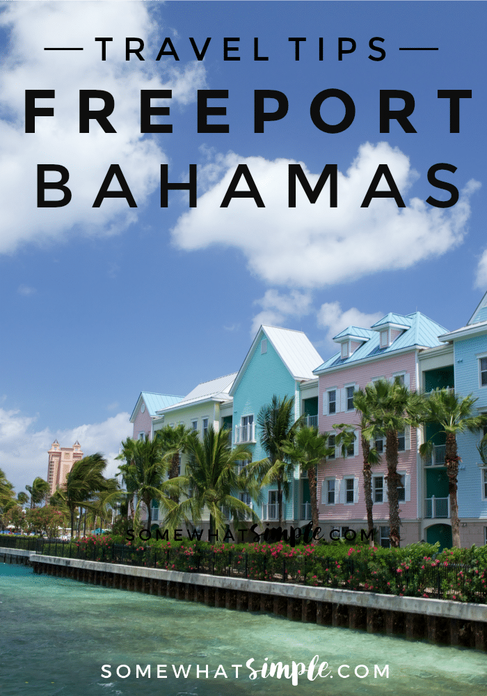 a row of colorful houses and palm trees that line the water in Freeport Bahamas