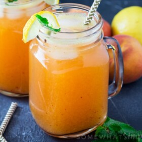 mason jars filled with fresh peach lemonade