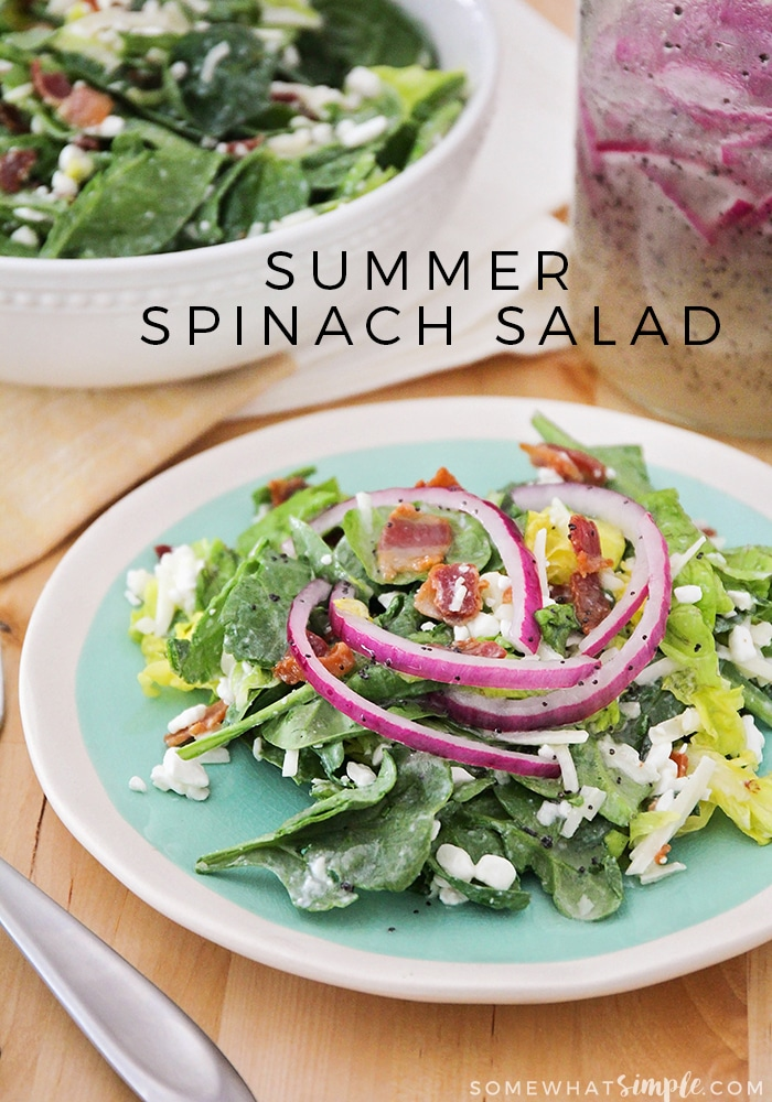 This spinach salad and poppyseed dressing pairs great with a hot day and is the perfect side dish for an outdoor party or BBQ! via @somewhatsimple
