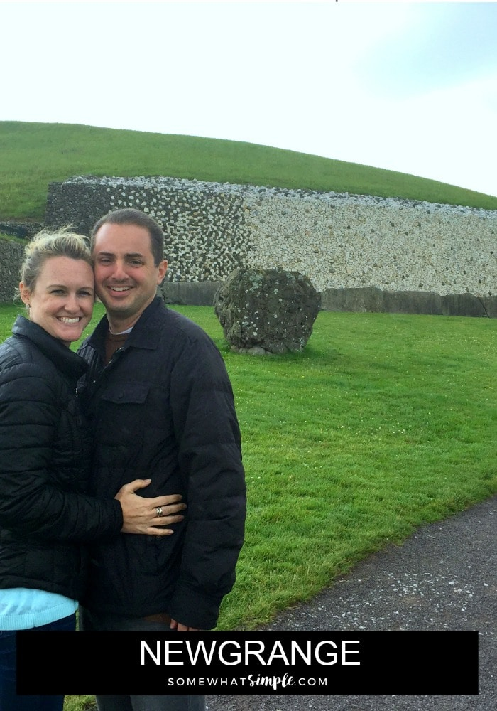 an attractive couple standing outside of Newgrange in Ireland
