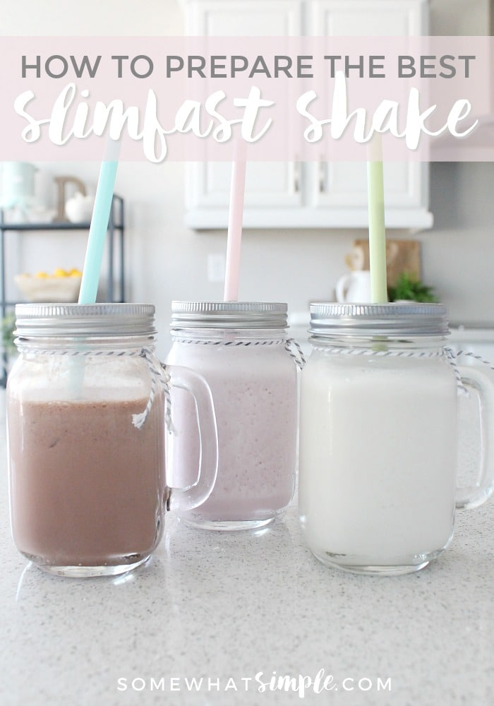 three mason jar glasses sitting on a a white counter each filled with one of these easy Slim Fast Shakes of Smoothie recipes. One is filled with a traditional chocolate slim fast smoothie, another has a vanilla slim fast smoothie and the last has a strawberry slim fast shake.