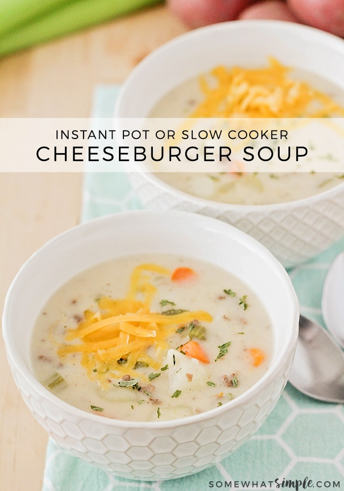 two white bowls of cheeseburger soup topped with shredded cheese