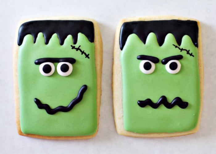 two cookies decorated to look like frankenstein