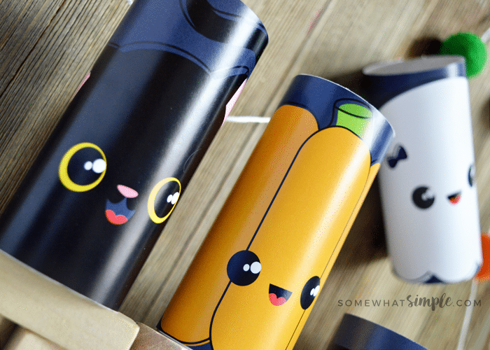 a black cat, pumpkin and ghost character toilet paper roll craft