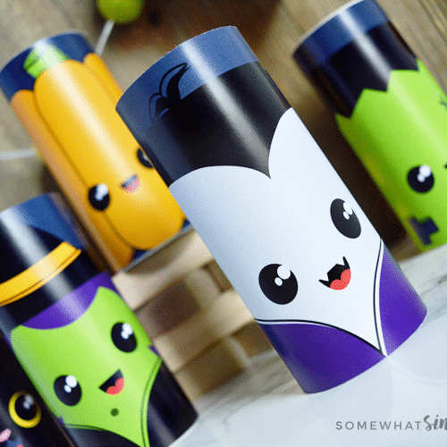several toilet paper crafts decorated with different Halloween characters