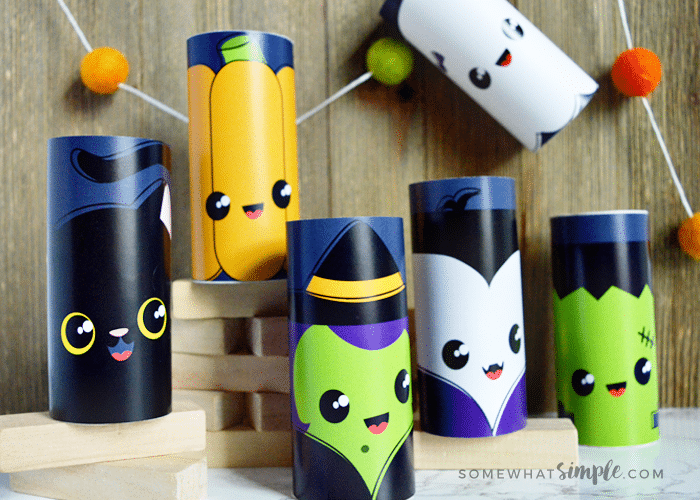 several toilet paper rolls made to look like Halloween characters made using this printable