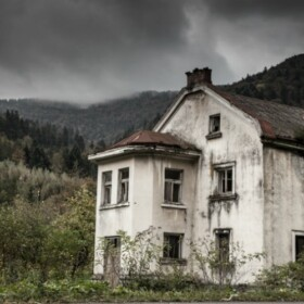 Old white hotel in a haunted field