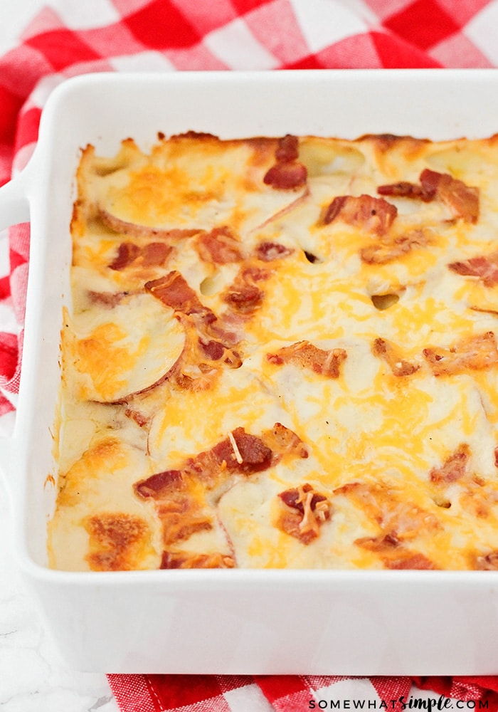 These delicious and savory cheddar bacon scalloped potatoes are the perfect easy-to-make side dish for any holiday dinner!