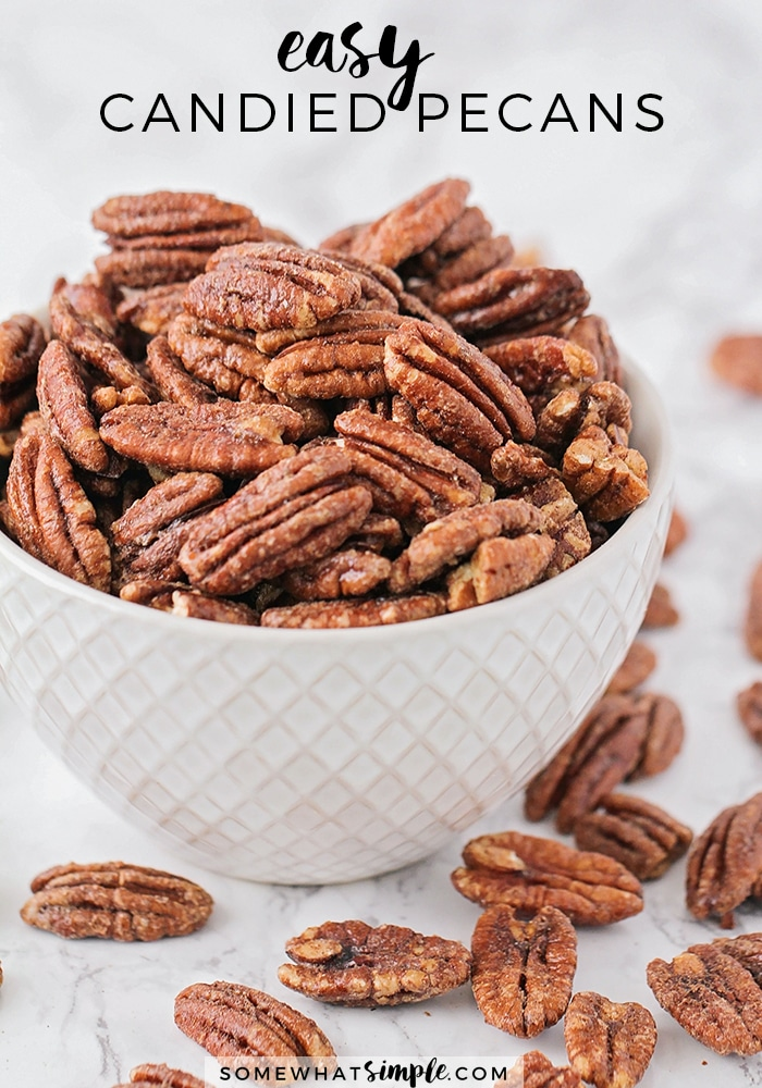 These delicious candied pecans have a sweet crunch and a touch of cinnamon. Covered in a brown sugar and cinnamon mixture, they're perfect for holiday gifts or party snacks! #howtocandypecans #candiedpecans #candiedpecansrecipe #homemadecandiedpecans #easycandiedpecans via @somewhatsimple
