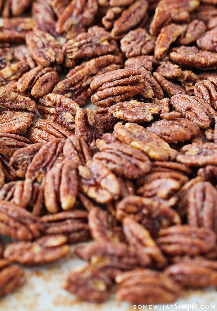 a baking sheet filled with baked pecans