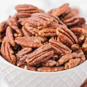 a bowl filled with candied pecans