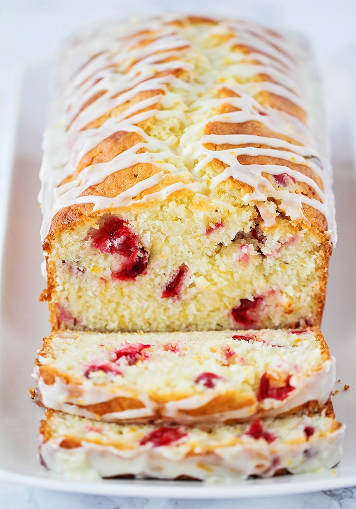 This delicious cranberry orange sweet bread is so easy to make and perfect for parties or gifting! It's so tender and sweet and loaded with cranberries!