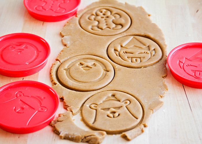 gingerbread cookie dough that has cookie cutter impressions
