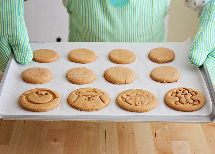 a tray of freshly baked gingerbread cookies