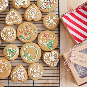 a cooling rack filled with decorated gingerbread cookies