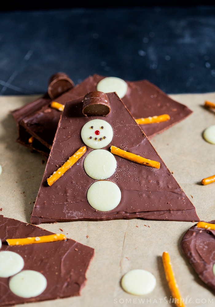 This fun and easy to make Snowman Bark is fun for the whole family. Cute, festive and tasty, you'll fall head over heels for this chocolatey bark!