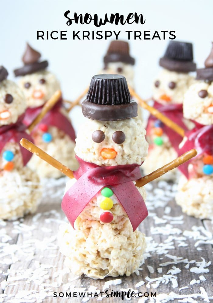 Snowman Rice Krispie treats are a fun holiday activity for kids that doubles as a tasty treat! These easy snowman treats are made with delicious peanut butter cups, m&ms and other delicious candies that everyone is sure to love! They're the perfect winter treat to enjoy during the Christmas season. via @somewhatsimple