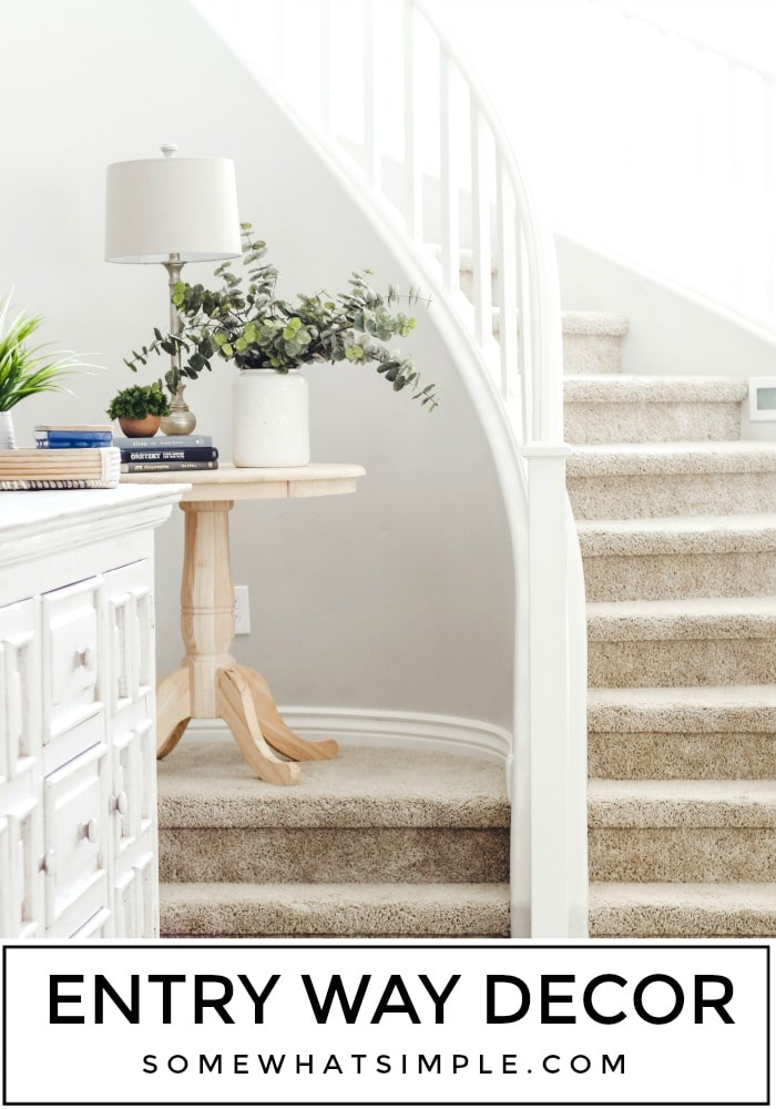 Our Entry Way - We've been in our house for 6 months now and every day I love it more! Here's a tour of the entry way of our new home! #entryway #entrywaytable #entrywayhomedecoridea #entrywaydecor #entrywayidea via @somewhatsimple