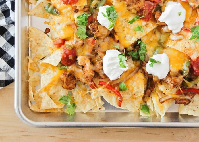 Chicken Fajita Nachos in a metal serving dish is easily one of my family's favorite super bowl foods