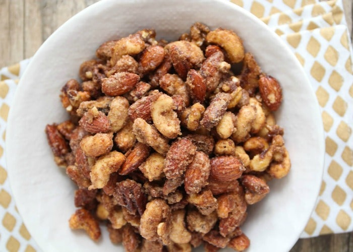 a bowl of Candied Mix Nuts is a fun super bowl snack to serve