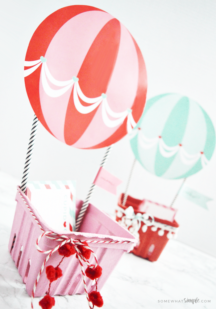 a red and a blue hot air balloon Valentine box made with these printables