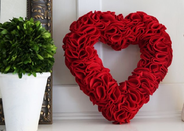 red felt wreath in the shape of a heart