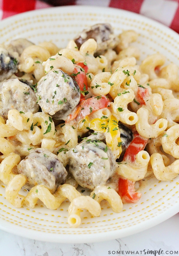 easy cajun cream sauce recipe in bowl with red and yellow bell peppers and sausage