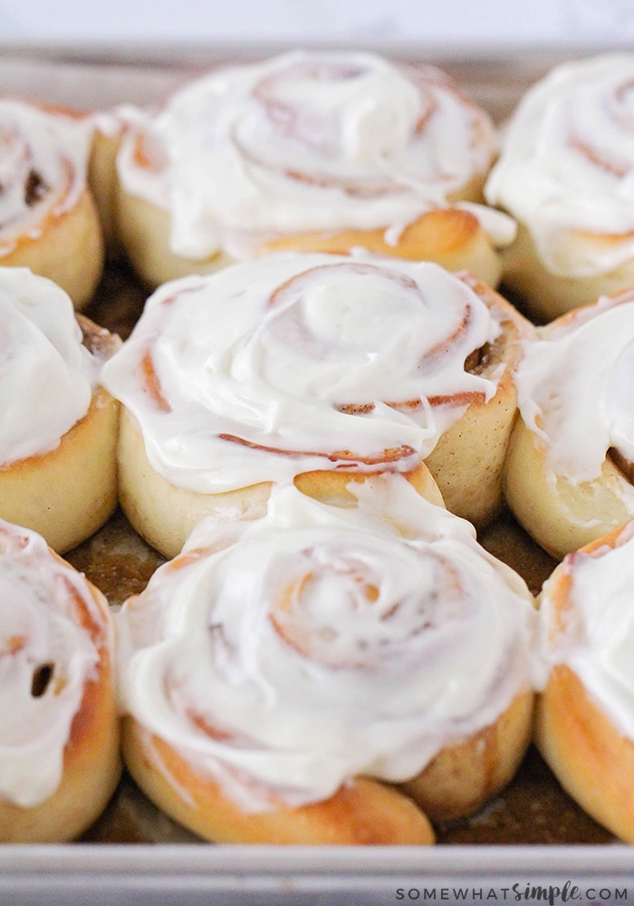 a tray of cinnamon rolls made with this easy recipe and topped with a cream cheese frosting