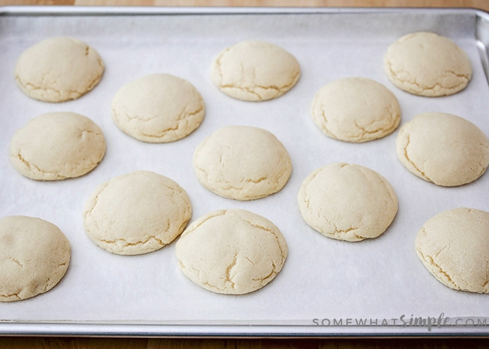 fully baked sugar cookies on a baking sheet using this easy 10 minute recipe