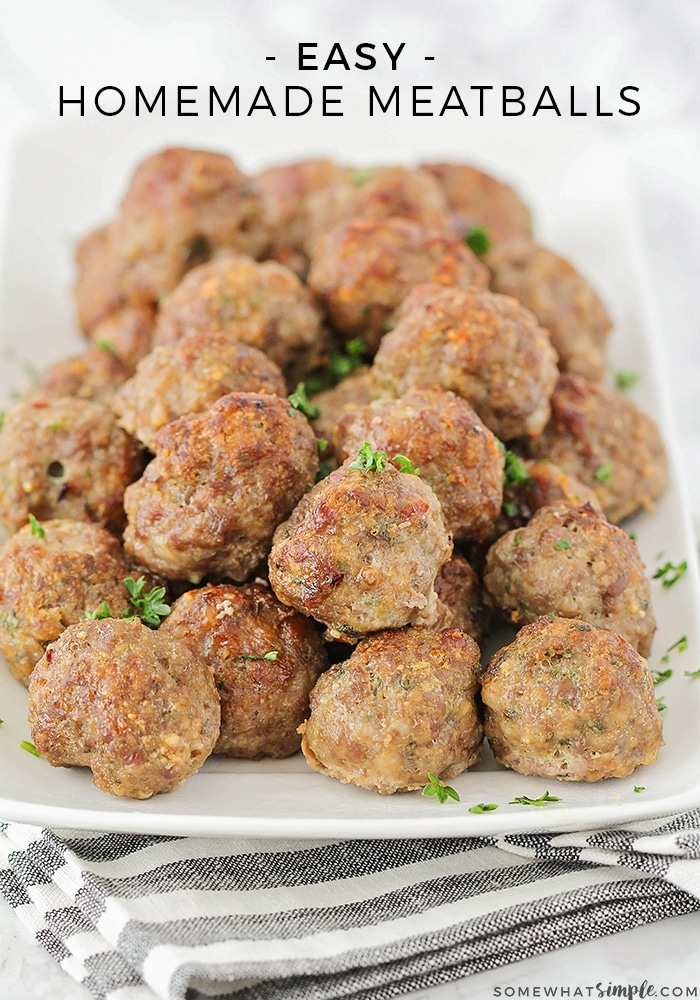 a tray of cooked homemade meatballs topped with parsley using this easy recipe with the words easy homemade meatballs at the top of the image