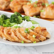 slices of teriyaki chicken with rice and broccoli