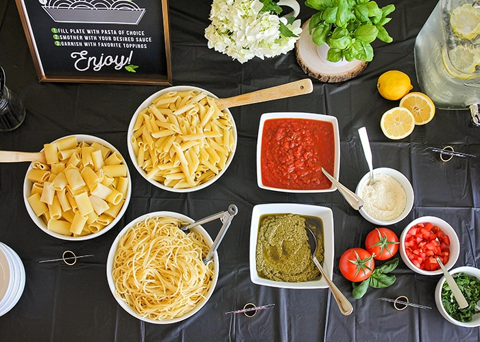 Host a fun and delicious dinner party at home with this easy Italian pasta bar! Mix and match pasta, sauce, and toppings to build the perfect bowl of pasta!