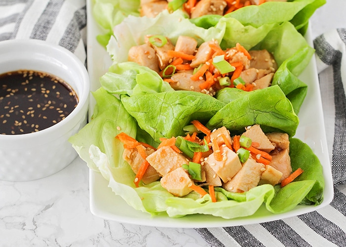 these easy chicken teriyaki lettuce wraps on a plate are a fun super bowl snack idea