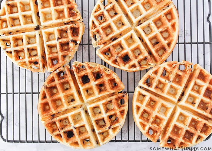 Looking down on four Belgian chocolate chip waffles on a cooling rack